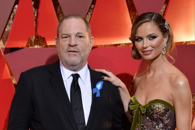 Producer Harvey Weinstein (L) and designer Georgina Chapman arrive on the red carpet for the 89th annual Academy Awards on February 26. On Sunday, the Weinstein Company. announced that Weinstein was fired after sexual abuse allegations. File Photo by Jim Ruymen/UPI