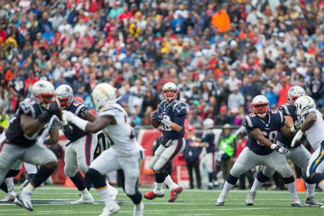 New England Patriots quarterback Tom Brady (12) drops back for a pass in the first quarter against the Los Angeles Chargers at Gillette Stadium in Foxborough, Massachusetts on October 29, 2017. The Patriots defeated the Chargers 21-13. Photo by Matthew Healey/UPI
