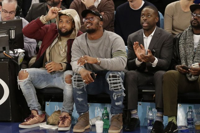 Odell Beckham Jr. Von Miller and Sterling K. Brown watch the New York Knicks play the Detroit Pistons at Madison Square Garden in New York City. File photo by John Angelillo/UPI