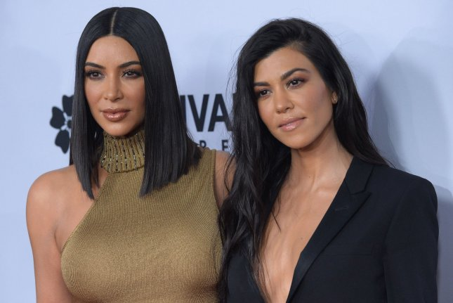 Kourtney Kardashian (R) and Kim Kardashian exchanged words on Twitter after reliving a fight through the Keeping Up with the Kardashians premiere. File Photo by Jim Ruymen/UPI