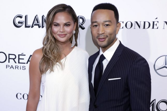 Chrissy Teigen (L) and John Legend will be featured on Season 31 of The Simpsons. File Photo by Jason Szenes/UPI