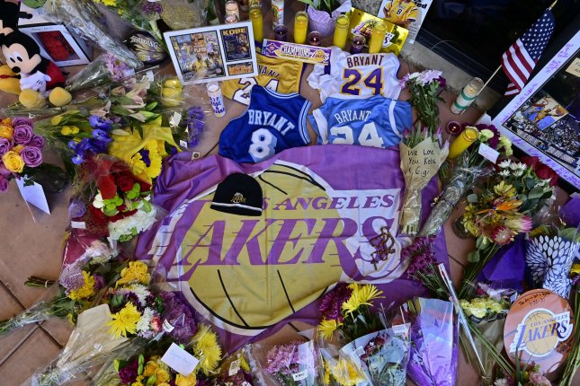 Flowers lie outside the entrance of the Mamba Sports Academy in Thousand Oaks, Calif., in memory of Kobe Bryant, who died in a helicopter crash Sunday in Calabasas, Calif. Photo by John McCoy/UPI