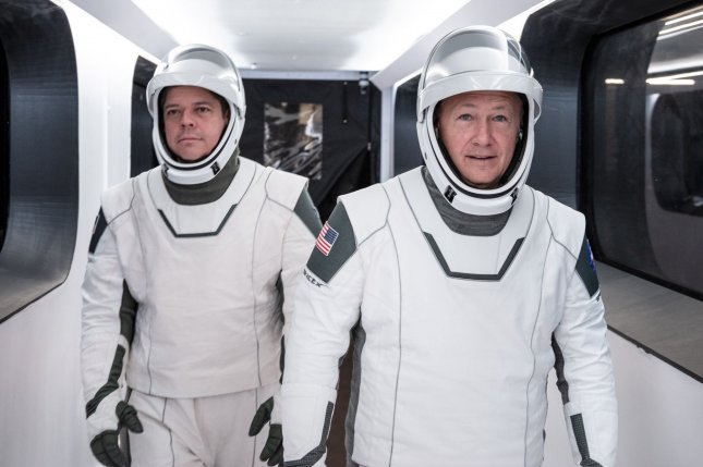 NASA astronauts Bob Behnken (L) and Doug Hurley wear SpaceX spacesuits as they prepare for the company's first crewed flight of the Dragon capsule, now set for May 27. Photo courtesy of SpaceX