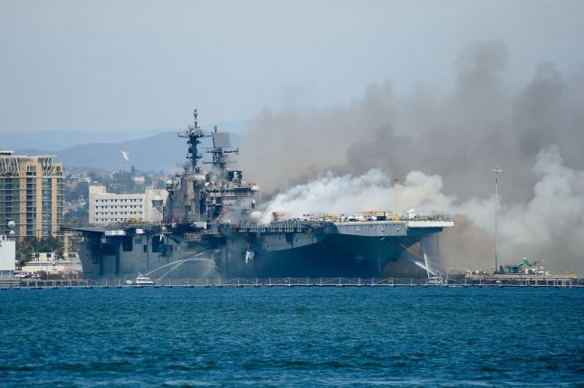 Federal and Navy firefighting crews battle a fire that erupted Sunday morning on the USS Bonhomme Richard. Photo by Lt. John J. Mike/U.S. Navy/UPI