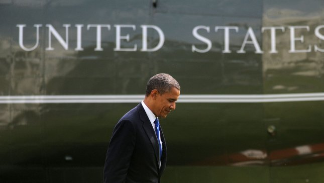 U.S. President Barack Obama walks on the South Lawn after arriving on Marine One at the White House in Washington, DC on September 27, 2012. President Obama was returning from a campaign event in Virginia Beach, Virginia. UPI/Olivier Douliery/Pool