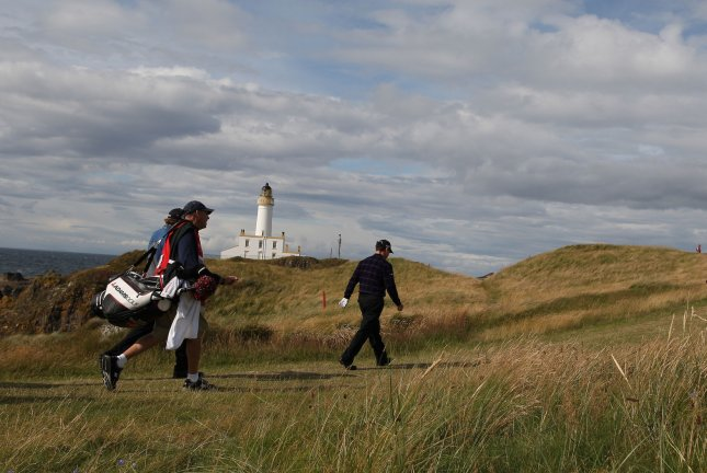 American Tom Watson walks past the lighthouse on the third day of the 138th British Open Championship in Turnberry, England on July 18, 2009. (UPI Photo/Hugo Philpott)