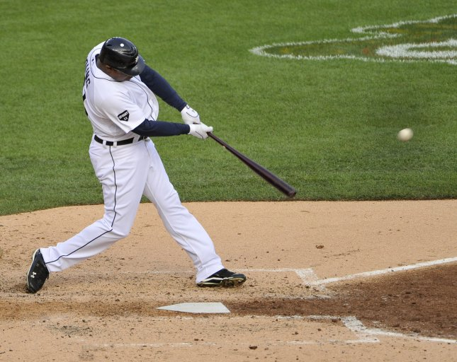 Detroit's Delmon Young connects on a solo home run against the Texas Rangers Oct. 13, 2011.UPI/Brian Kersey