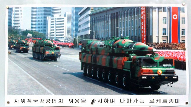 A photo of a mobile, long-range missile launcher, which has alarmed the Pentagon, is displayed on a picture board in front of the North Korean embassy in Beijing on March 22, 2013. China is willing to promote dialogue between North and South Korea as stability on the Korean peninsula is also in China's best interest, President Xi Jinping told his South Korean counterpart this week. Beijing is North Korea's sole diplomatic and economic ally, but relations have been strained by Pyongyang's bellicose actions and threats to the United States and South Korea. UPI/Stephen Shaver