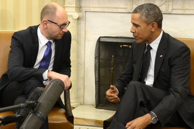 U.S. President Barack Obama (R) confers with Ukraine's Prime Minister Arseniy Yatsenyuk during a bilateral meeting in the Oval Office, in Washington, DC, March 12, 2014. The leaders discussed the crisis in Ukraine and Crimea, in the aftermath of the removal of former PM Viktor Yanukovych from power and Russia's move into Crimea. UPI/Mike Theiler