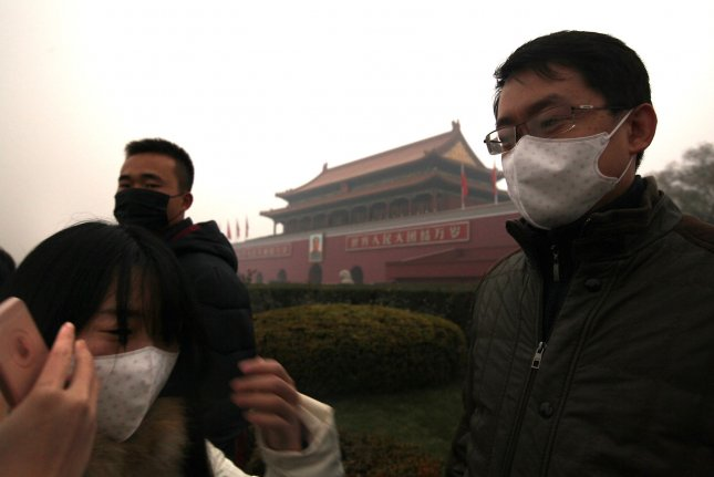 Tourists visit Tiananmen Square on Friday as hazardous air pollution hits Beijing again. China warned residents across a large part of northern China to prepare of a wave of choking smog arriving over the weekend, the worst of which is expected to hit China's capital, prompting the government to issue its second ever red alert. Photo by Stephen Shaver/UPI