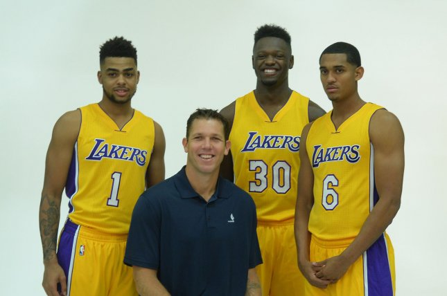 D'Angelo Russell (1), Julius Randle (30) and Jordan Clarkson (6) of the Los Angeles Lakers pose for a photo with head coach Luke Walton during Laker media day at Toyota Sports Center on September 26, 2016 in El Segundo, California. Photo by Jim Ruymen/UPI