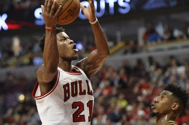 Chicago Bulls guard Jimmy Butler (L). Photo by Brian Kersey/UPI
