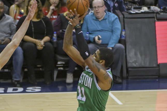 Boston Celtics guard Kyrie Irving (11) scores in the first half on February 8, 2018 at Capital One Arena in Washington, D.C. Photo by Mark Goldman/UPI