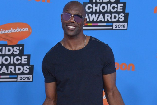 Former NFL player Terrell Owens arrives for the 31st annual Nickelodeon Kids' Choice Awards on March 24. File Photo by Jim Ruymen/UPI