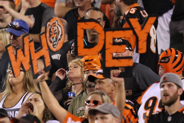Cincinnati Bengals fans cheer for their team against the Baltimore Ravens defense during the first half of play on September 13 at Paul Brown Stadium in Cincinnati. Photo by John Sommers II/UPI