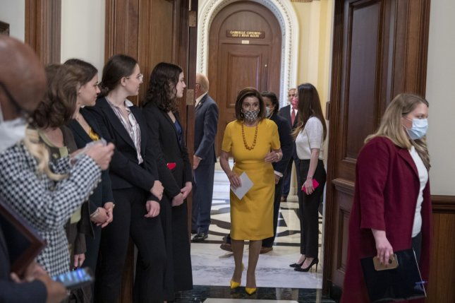 House Speaker Nancy Pelosi arrives Tuesday for a swearing-in ceremony at the U.S. Capitol in Washington, D.C. Wednesday, she enacted a rule allowing House lawmakers to participate in remote sessions for another six weeks. Photo by Tasos Katopodis/UPI