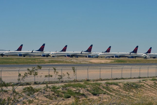 Grounded commercial aircraft are stored at Victorville Logistics Airport in Victorville, Calif., on April 22. With a sharp drop in travel due to the pandemic and stimulus funding set to expire, some 30,000 airline workers face layoffs beginning Thursday. File Photo by Jim Ruymen/UPI