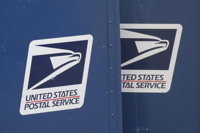 A U.S. postal worker has been charged with illegally discarding mail, including ballots for November's general election. Photo by John Angelillo/UPI