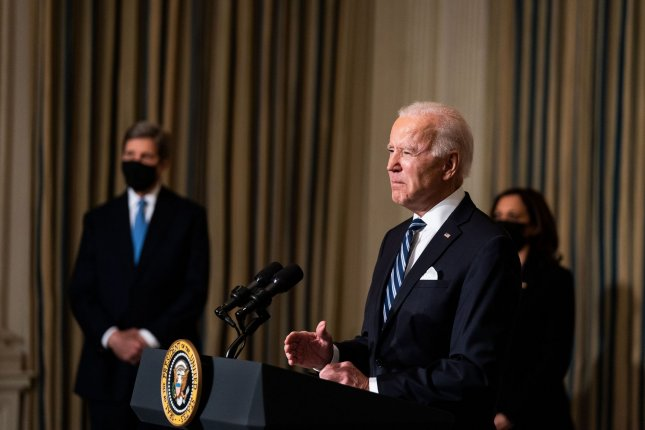 President Joe Biden, flanked by climate czar John Kerry and Vice President Kamala Harris, delivers remarks on his administration's response to climate change at a White House event Wednesday. Pool Photo by Anna Moneymaker/UPI