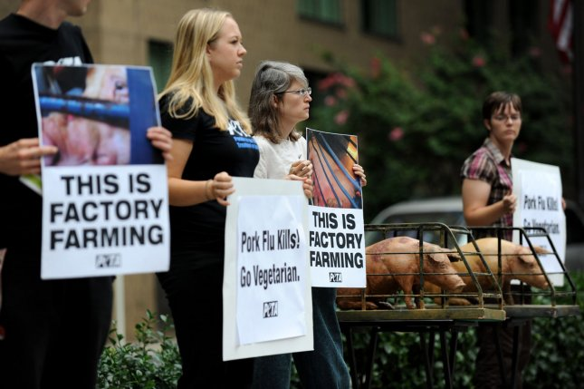 Members of PETA (People for the Ethical Treatment of Animals) protest against factory pig farming outside of the International Swine Flu Conference in Washington on August 19, 2009. UPI/Kevin Dietsch
