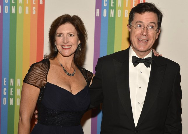 Comedian Stephen Colbert and his wife Evelyn pose for photographers on the red carpet as they arrive for an evening of gala entertainment at the Kennedy Center, December 1, 2012, in Washington, DC. The annual Kennedy Center Honors are bestowed annually on five artists for their lifetime achievement in the arts and culture. UPI/Mike Theiler