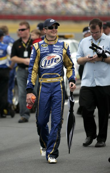 Race car driver Kurt Busch walks down pit road with an umbrella before a NASCAR event in North Carolina May 25, 2009. (UPI Photo/Nell Redmond)