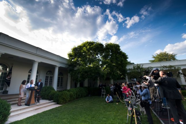 President Obama (right) listens as Bob Bergdahl (center) makes a statement and Jani Bergdahl (left) looks on regarding the release of their son Sgt. Bowe Bergdahl by the Taliban, May 31, 2014, in the Rose Garden at the White House in Washington, D.C. Army Sgt. Bowe Bergdahl was taken prisoner after leaving his base in east Afghanistan on June 30, 2009. UPI/J.H. Owen/Pool