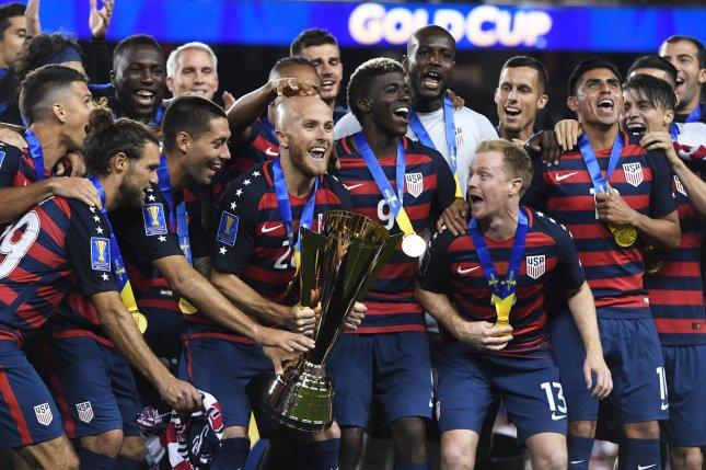 USA players celebrate with the Gold Cup after defeating Jamaica in the CONCACAF Gold Cup at Levi's Stadium in Santa Clara on July 26, 2017. The USA won 2-1. Photo by Terry Schmitt/UPI