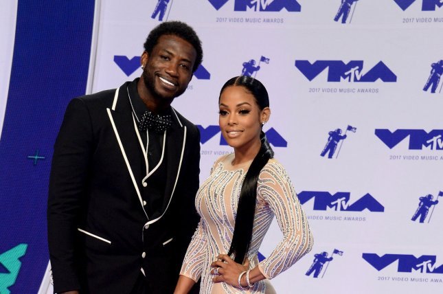 Gucci Mane (L) and Keyshia Ka'oir tied the knot Tuesday at the Four Seasons in Miami, Fla. File Photo by Jim Ruymen/UPI