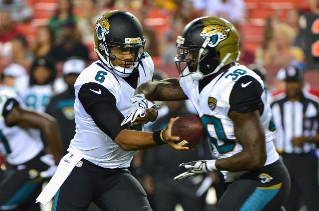 Former Jacksonville Jaguars quarterback Stephen Morris (6) hands off to running back Bernard Pierce (30) in the first quarter against the Washington Redskins on September 3, 2015 at FedEx Field in Washington, D.C. File photo by Kevin Dietsch/UPI