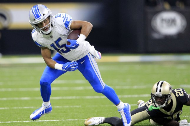 Detroit Lions Wide Receiver Golden Tate 15 Shakes Off New Orleans Saints Cornerback Ken Crawley 20 For A 19 Yard Gain In The Second Quarter On October