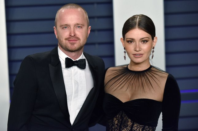 Aaron Paul (L) with his wife Lauren Persekian. Paul stars in the new trailer for Westworld Season 3 along with Evan Rachel Wood. File Photo by Christine Chew/UPI