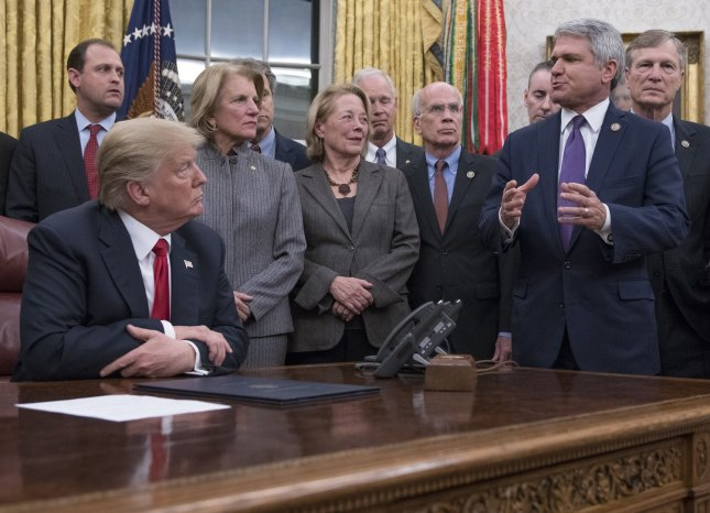 United States President Donald J. Trump listens as Rep. Michael McCaul speaks in the Oval Office of the White House in Washington, D.C., on Jan. 10, 2018. Photo by Ron Sachs/UPI