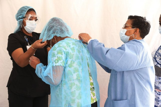 Nurses get prepared to do testing at a new coronavirus testing center at the Affinia Health Care, in St. Louis on April 22. Photo by Bill Greenblatt/UPI