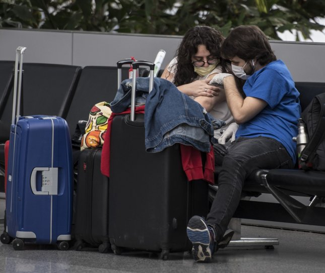 The Trump administration informed airports and airlines on Thursday to require passengers to wear face masks and practice social distancing while commuting by plane. Photo by Terry Schmitt/UPI