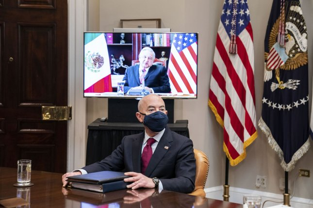 Secretary of Homeland Security Alejandro Mayorkas listens as President Joe Biden participates in a virtual meeting with President Andrés Manuel López Obrador of Mexico in the Roosevelt Room of the White House on March 1. Pool Photo by Anna Moneymaker/UPI