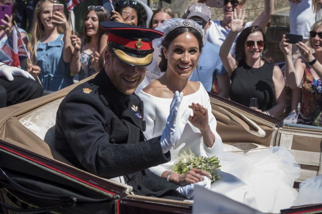 Meghan Markle (R) and Prince Harry ride in a horse-drawn carriage on their wedding day in May 2018. The Royal Family wished Markle a happy birthday on social media. Pool photo by Stephen Chung/UPI