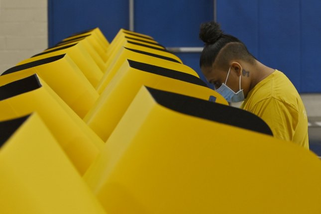 A woman casts her ballot in California's gubernatorial recall election at the Bellevue Recreation Center in Los Angeles on Tuesday. Photo by Jim Ruymen/UPI