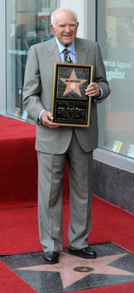 Judge Joseph A. Wapner, former host of the television series The People's Court, holds a replica plaque after Wapner received the 2,392nd star on the Hollywood Walk of Fame in Los Angeles on November 12, 2009. Wapner died Sunday at the age of 97. File Photo by Jim Ruymen/UPI