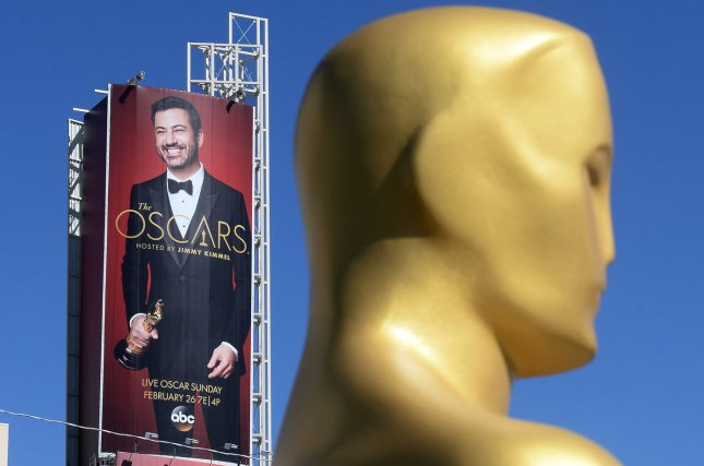 A poster of show host Jimmy Kimmel looms over an Oscar statue awaiting their placement on the red carpet on February 23. Kimmel opened the show with jokes about President Donald Trump and Matt Damon. Photo by Jim Ruymen/UPI