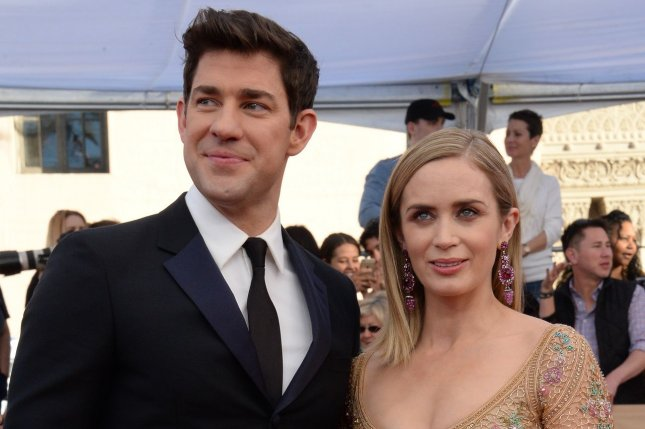 John Krasinski (L), pictured with Emily Blunt, said NBC hasn't approached him about an Office revival. File Photo by Jim Ruymen/UPI