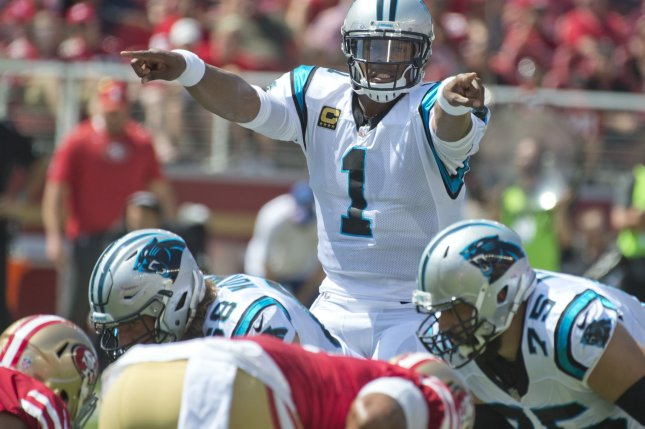 Carolina Panthers QB Cam Newton stands behind his offensive line on September 10 at Levi's Stadium in Santa Clara, Calif. File photo by Terry Schmitt/UPI