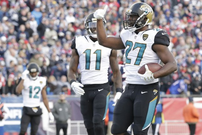 Jacksonville Jaguars running back Leonard Fournettte celebrates a touchdown run against the New England Patriots during the AFC Championship at Gillette Stadium in Foxborough, Massachusetts on January 21, 2018. Photo by John Angelillo/ UPI