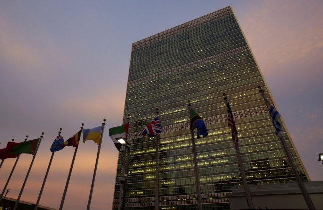 International flags fly at the base of the United Nations Building at sunset for the 72nd General Debate at the United Nations General Assembly at United Nations Headquarters at GA Hall in New York City on September 21, 2017. A Gallup poll released Monday found that most Americans support the NATO Alliance and the United Nations. Photo by John Angelillo/UPI