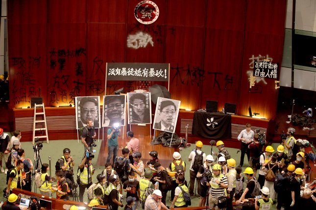 Protesters gather in the Legislative Council's Chamber during a demonstration on the 22nd anniversary of the territory's handover to China on Monday. Photo by Stephen Shaver/UPI