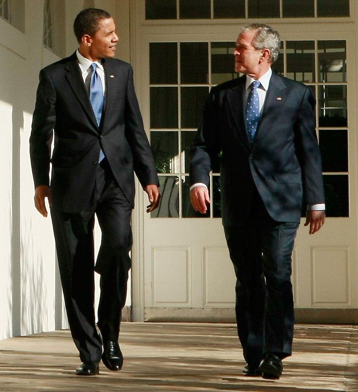 U.S. President George W. Bush (R) walks with President-elect Barack Obama as he welcomes him to the White House in Washington on November 10, 2008. (UPI Photo/Mark Wilson/Pool)