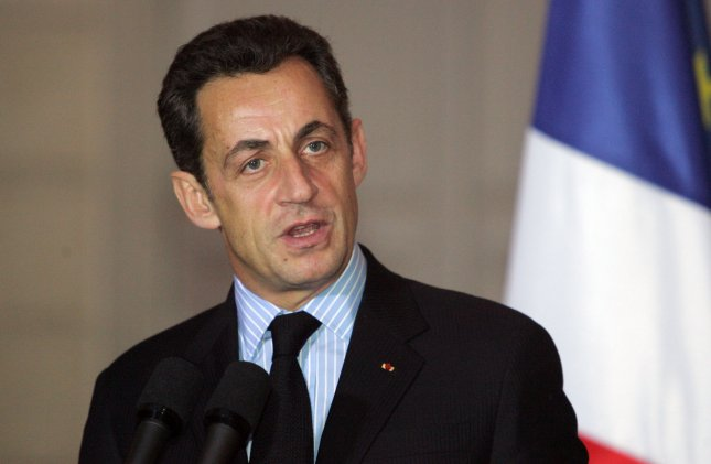 French President Nicolas Sarkozy speaks to journalists during a press briefing at the Elysee Palace in Paris, December 10, 2007. Sarkozy defended a visit by Moammar Gadhafi, denying he had betrayed France's human rights heritage by inviting the Libyan leader, and said securing lucrative contracts for French firms would not prevent him championing human rights. (UPI Photo/Eco Clement)