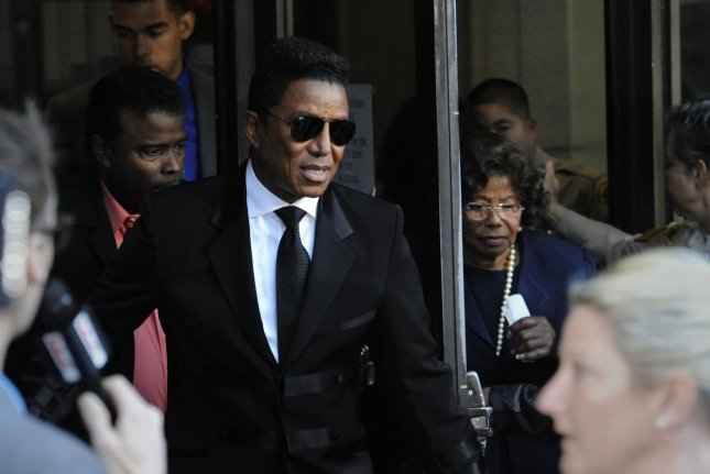 Jermaine Jackson (L) and Katherine Jackson (R) leave the courthouse following Dr. Conrad Murray's sentencing in Los Angeles on November 29, 2011. Murray was sentenced to four years for manslaughter in the death of Michael Jackson. UPI/Phil McCarten