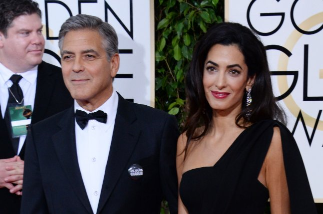 Actor George Clooney and his wife, human rights attorney Amal Alamuddin Clooney, attend the 72nd annual Golden Globe Awards at the Beverly Hilton Hotel in Beverly Hills, Calif., on Jan. 11, 2015. Photo by Jim Ruymen/UPI