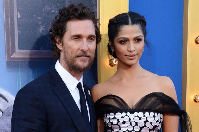 Matthew McConaughey (L) and Camila Alves at the Los Angeles premiere of Sing on December 3. The actor played Rust Cohle on True Detective Season 1. File Photo by Jim Ruymen/UPI